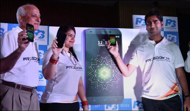 Mohit Goesl (Director) of Ringing Bells with Dharna Goel (CEO) launches Freedom LED TV and New Smartphones in New Delhi (PTI )